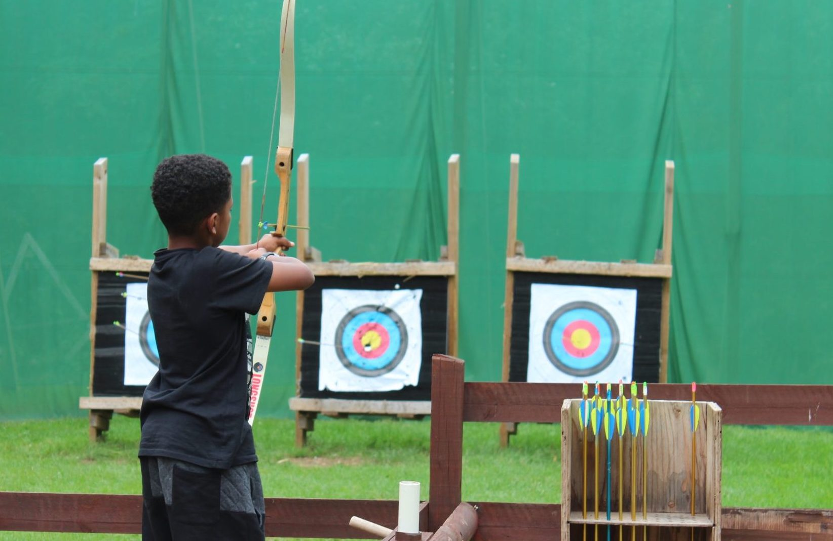 boy doing archery
