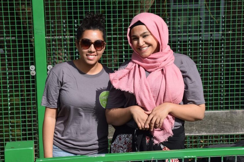 Two volunteers stood together smiling at SkyWay