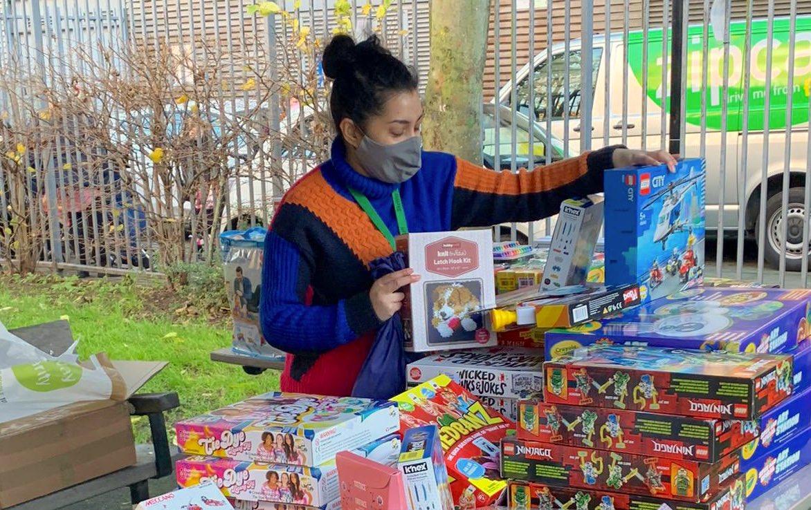 Volunteer organising Christmas present packages at SkyWay