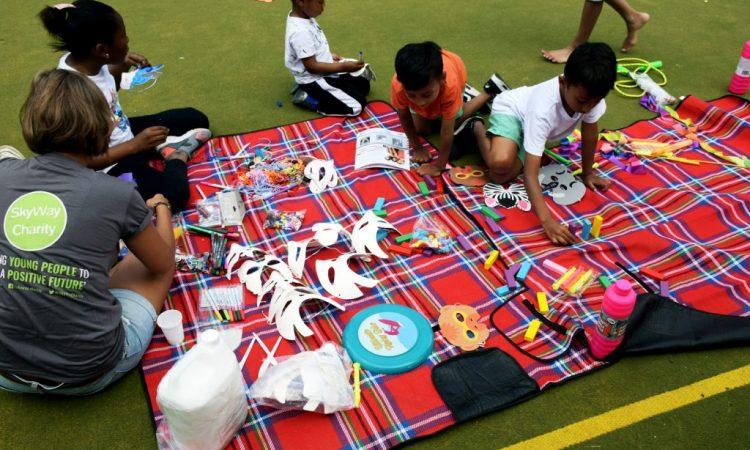 Children doing activities on blankets