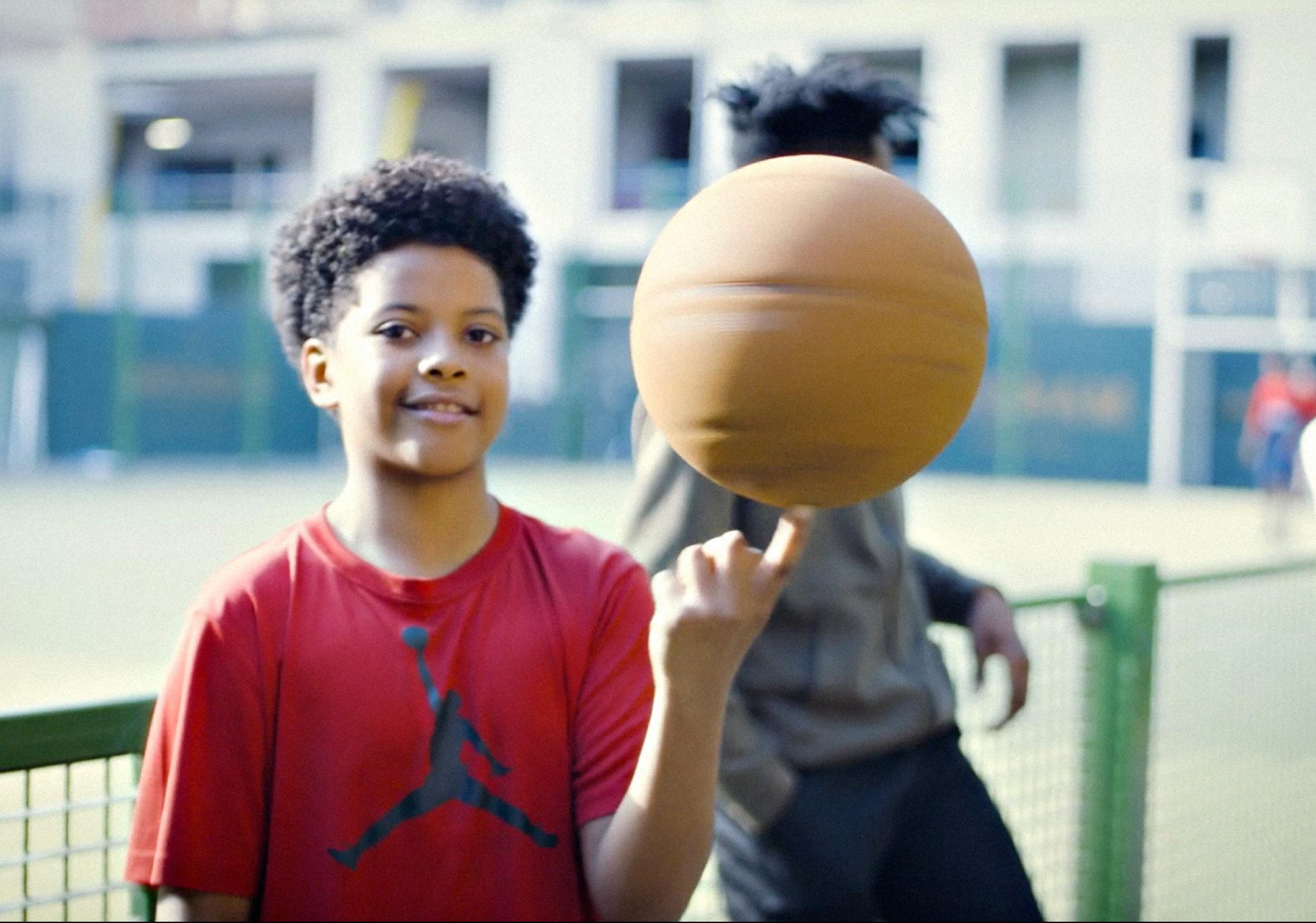 boy spinning basketball
