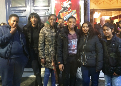 A group of young people outside the Garrick Theatre