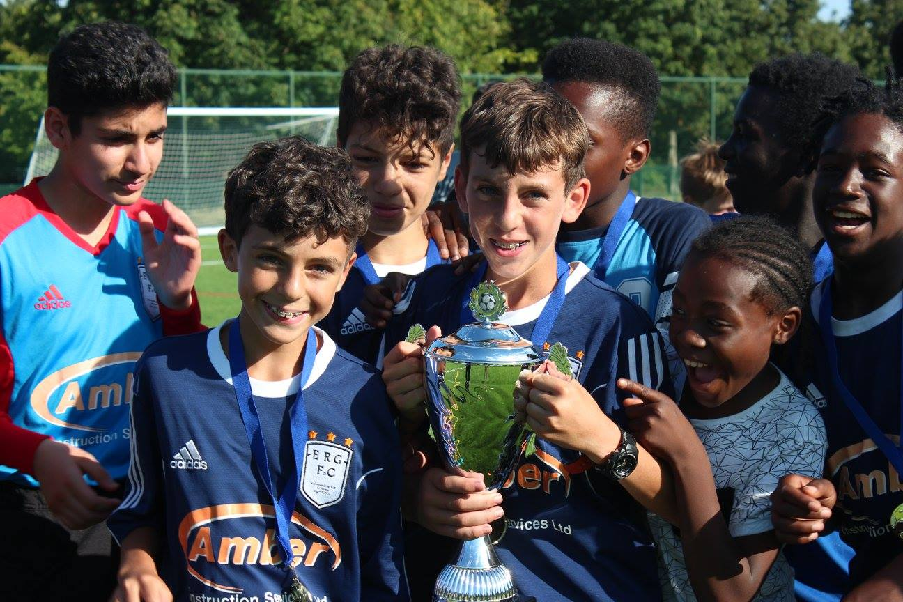Group of boys holding a trophy
