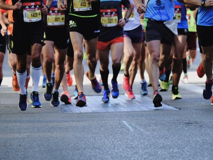 Marathon runners legs shot